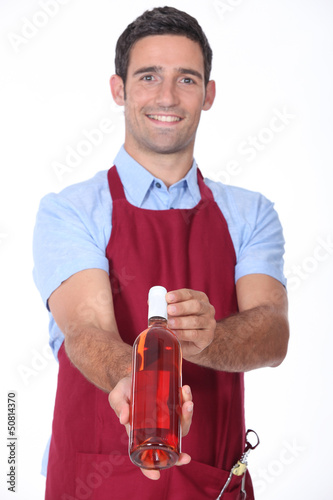 Waiter offering bottle of wine