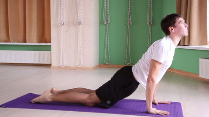 young and handsome man doing yoga 3