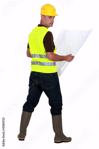 Tradesman looking at a blueprint