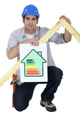 Carpenter kneeling with energy efficiency banner