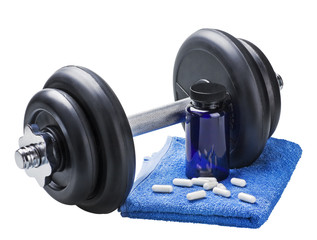 dumbbell and pills isolated on white background