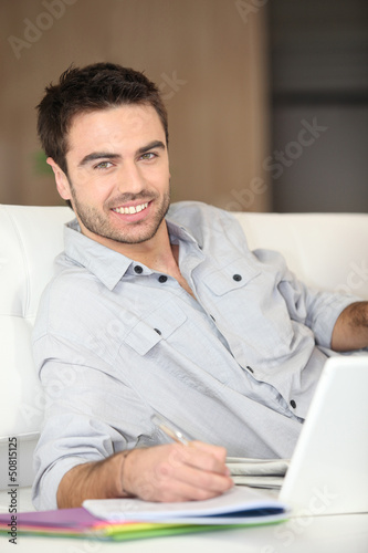 Man working from living room