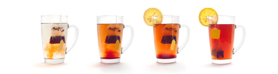 The process of making tea in a glass cup with a lemon. Tea bag.