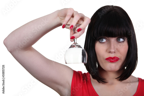 Woman with an empty wine glass