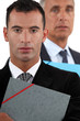 Businessmen holding documents
