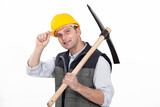 Man with ax tipping helmet
