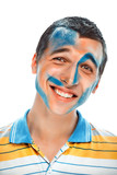 portrait of a smiling young handsome guy with paint on his face