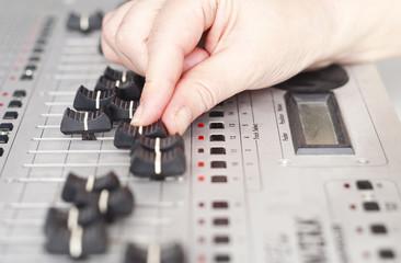 hand of dj on mixer