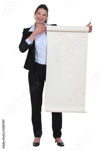 Businesswoman holding a poster