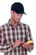 Electrician wearing a cap