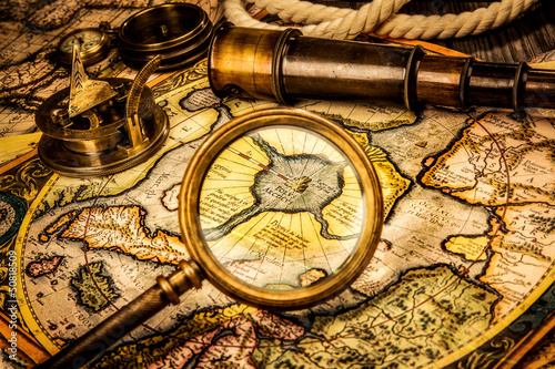 Papiers peints Arctique Vintage magnifying glass lies on the ancient map of the North Po