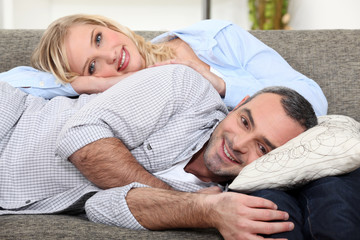 Couple lying on a sofa