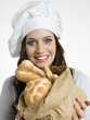 Smiling chef with italian bread