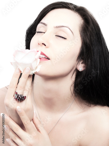 pretty young woman with a fragrant rose - isolated