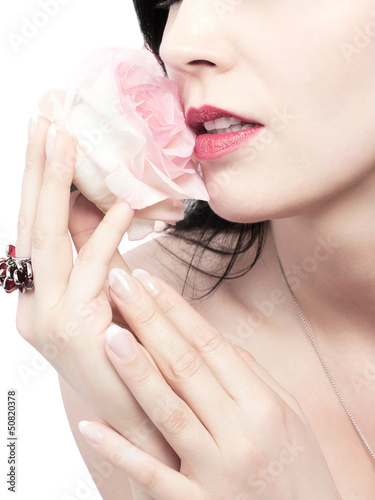 young woman with a fragrant rose - isolated
