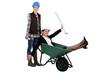 Woman pushing another woman in wheelbarrow
