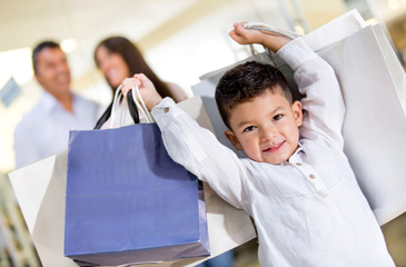 Happy little boy shopping