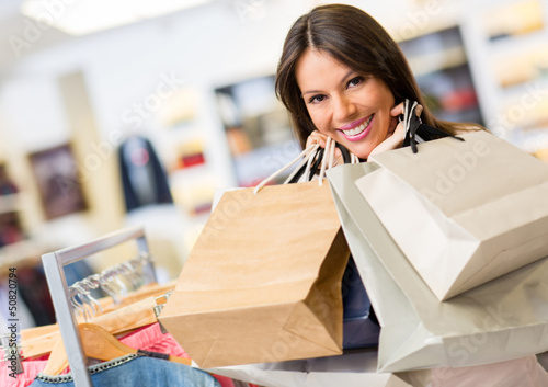Portrait of shopaholic woman smiling