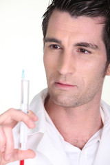man holding an injection
