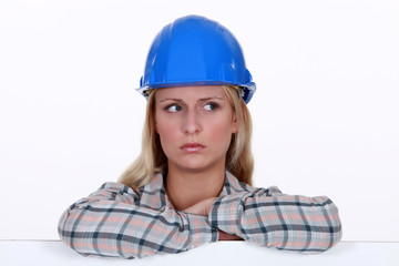 portrait of worried handywoman