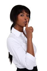Businesswoman shushing