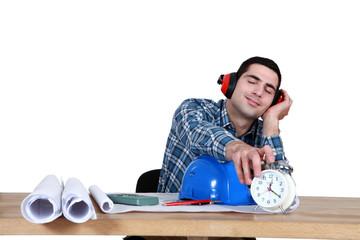 Architect hitting turning alarm clock off