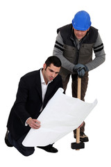 Construction worker working together with an engineer