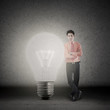 Businessman and bright light bulb