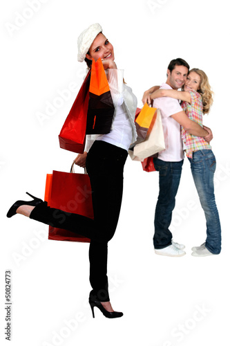 Three people returning from shopping trip