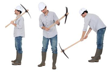 Woker holding pick axe