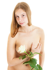 portrait of a beautiful nude woman with white rose