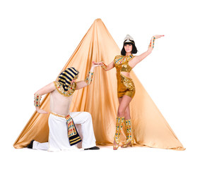 dancers dressed as Egyptian posing against pyramid