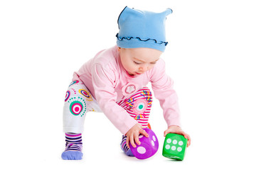 baby is playing with  toys over white background.