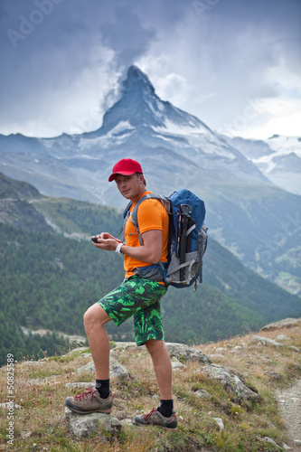 hiker is looking for the route