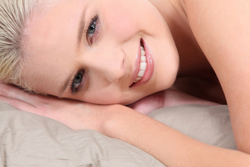 Blond woman laying in bed