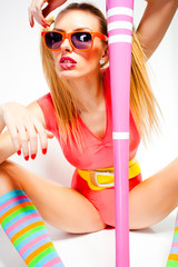 sexy baseball girl wearing colorful clothes posing