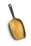 brown sugar in metal scoop