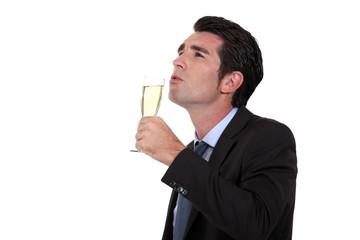 Businessman, drinking champagne, alone