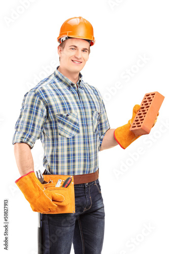 Male construction worker with helmet holding a brick