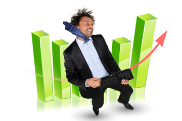 Excited businessman stood by graph