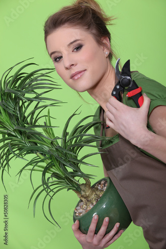 Young woman tending to her plants