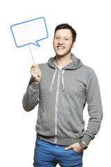 Man holding a speech bubble sign smiling