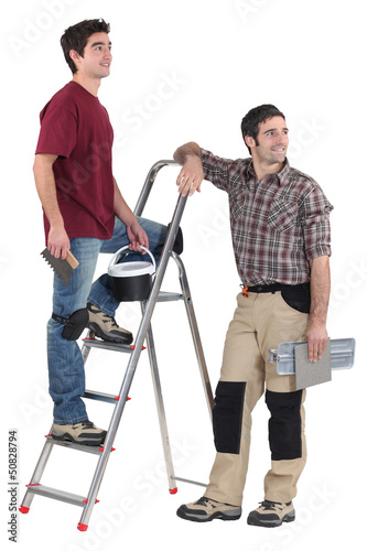 Two tilers pausing to look at something