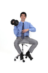 businessman holding a dumbbell