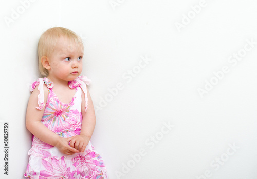 Little girl punished and standing in the corner