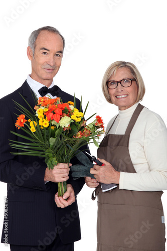 Portrait of a florist and a man wearing a tuxedo