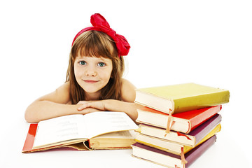 Beautiful little girl with school books on the table