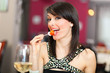 Beautiful woman eating appetizer in a restaurant