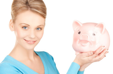 lovely woman with big piggy bank