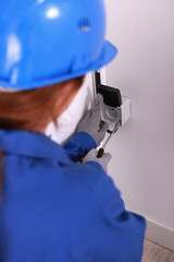 Female electrician installing a continental socket